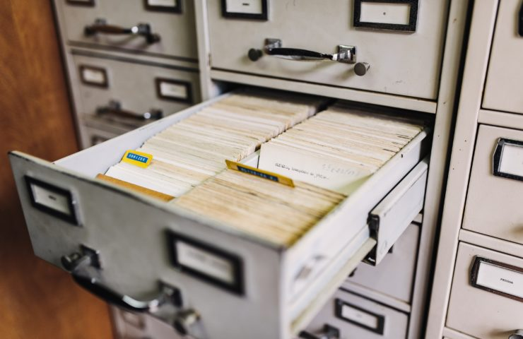 Picture of a filing cabinet with an open drawer